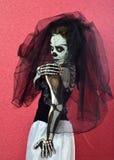 Girl makeup skeleton. Skeleton Girl on red background royalty free stock image