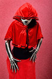 Girl makeup skeleton in red cape Stock Photography