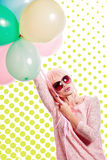 Girl with makeup in the style of pop art and balloons. Colored b Stock Photo