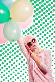 Girl with makeup in the style of pop art and balloons. Colored b Royalty Free Stock Photos