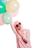 Girl with makeup in the style of pop art and balloons. Stock Photo