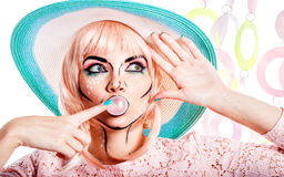 Girl with makeup in style pop art bubble from chewing gum. Royalty Free Stock Image