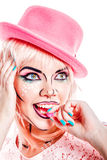 Girl with makeup in style pop art is eating candy. Stock Images