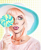 Girl with makeup in style of pop art, hat and lollipop. Colored Royalty Free Stock Image