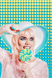 Girl with makeup in style of pop art, hat and lollipop. Colored Stock Photo