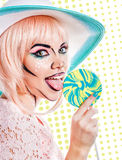 Girl with makeup in style of pop art, hat and lollipop. Colored Stock Images