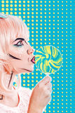 Girl with makeup in the style of pop art and lollipop. Color bac Royalty Free Stock Images