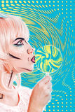Girl with makeup in the style of pop art and lollipop. Color bac Royalty Free Stock Photography