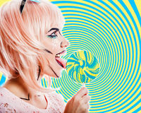 Girl with makeup in the style of pop art and lollipop. Color bac Royalty Free Stock Photo