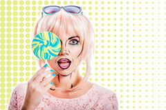 Girl with makeup in the style of pop art and lollipop. Color bac Stock Photography