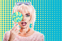 Girl with makeup in the style of pop art and lollipop. Color bac Stock Photos