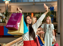 Girl makin selfie at mall Stock Photography