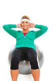 Girl making abdominal crunch on fitness ball Stock Photos