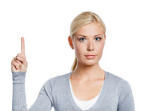 Girl making attention gesture Stock Image