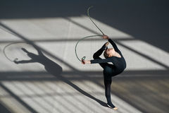 Girl making   balance rope. rhythmic gymnastics. Royalty Free Stock Image