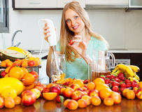 Girl making  beverages with  electric blender Stock Photography