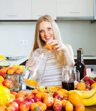 Girl making beverages with fruits Royalty Free Stock Photography