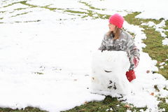 Girl making a big snow ball Royalty Free Stock Photography
