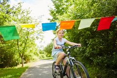 Girl making bike trip in the park. In summer for movement stock images