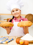 Girl making bread Royalty Free Stock Photo