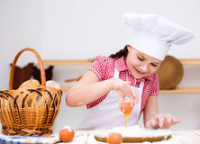 Girl making bread Stock Image