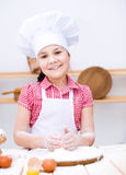 Girl making bread Royalty Free Stock Images