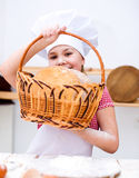 Girl making bread Royalty Free Stock Image