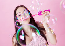 Girl making bubbles Royalty Free Stock Photos