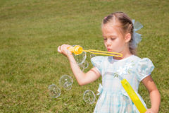 Girl Making Bubbles Stock Photo