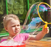 Girl making Bubbles Stock Images