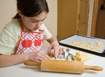 Girl making cakes Stock Photo