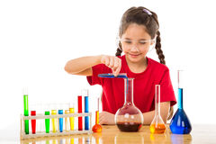 Girl making chemical experiments Stock Images