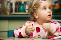 Girl making Christmas cookies Royalty Free Stock Photos