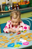 Girl making Christmas cookies Stock Photography