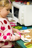 Girl making Christmas cookies Stock Images