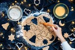 Girl making the Christmas cookies. Overhead shot of girl making the Christmas cookies Royalty Free Stock Photography