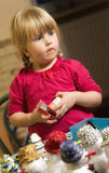 Girl making Christmas decorations Royalty Free Stock Photos