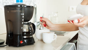 Girl making coffee. close-up stock photos