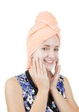 Girl making cosmetic packs. Isolated over white Royalty Free Stock Images