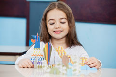 Girl Making Craft In Preschool Stock Photos