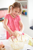 Girl Making Cupcakes In Kitchen Stock Photography