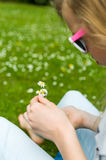 Girl making a daisy chain Royalty Free Stock Photo