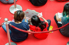 Girl making a drawing for Joseph Schooling, the Singapore's first Olympic gold medalist, at Raffles City. August 18, 2016. Crowd waiting with colourful banners royalty free stock photos