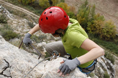 Girl making an effort doing a via ferrata Stock Photography