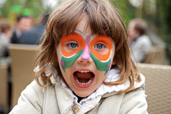 Girl making face painting - Butterfly. Portrait of girl with painted face Butterfly stock photos