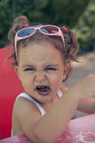 Girl making faces while looking at camera Royalty Free Stock Photography