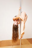 Girl making figure of poledance Stock Photos