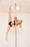 Girl making figure of poledance Stock Images