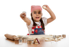 Girl making forms out of dough Stock Images