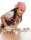 Girl making forms out of dough Royalty Free Stock Images